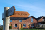 The Old Stables and bridleway sign