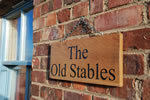 The Old Stables sign